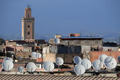Satellite dishes on roofs — Stock Photo