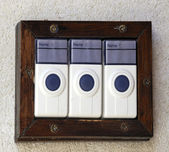 Three door bells — Stock Photo