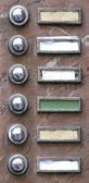 Old apartment buzzers - names removed — Stockfoto