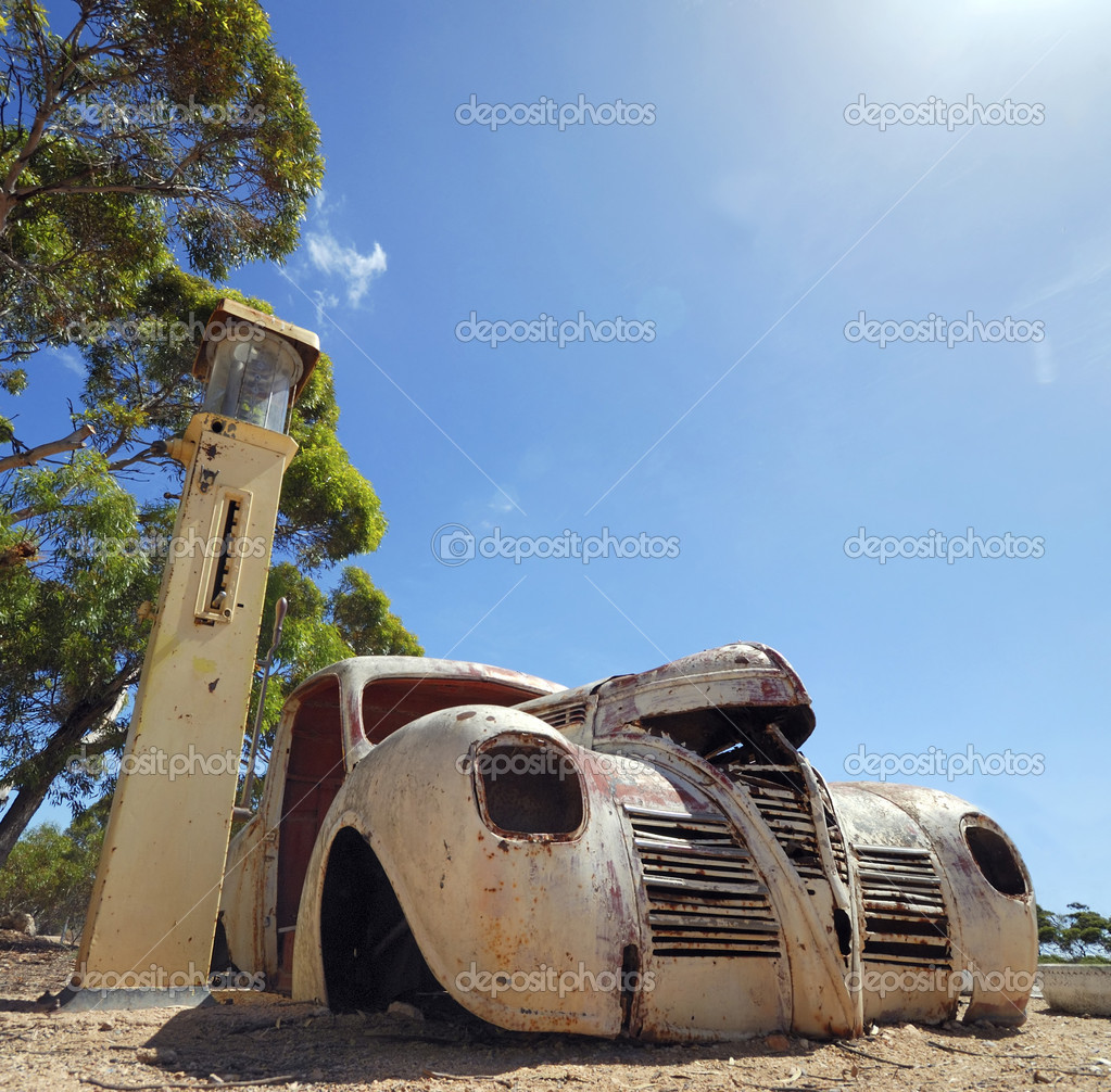 Rusty old american car in a ghost town — Stock Photo #8442708