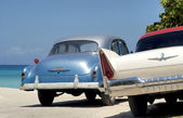 Old cars at the beach — Stock Photo