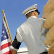 American soldier with the American national flag — Stockfoto