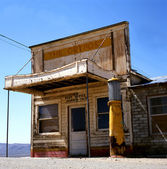 Old post office with gas station — Stock Photo