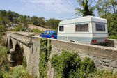 Caravan at a bridge — Stock Photo