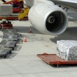 Loading airplane with airfreight — Stock Photo #8591879