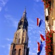 New church and flags at the market place in Delft. - Stock Photo