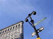 Flat Iron building with street sign — Stock Photo