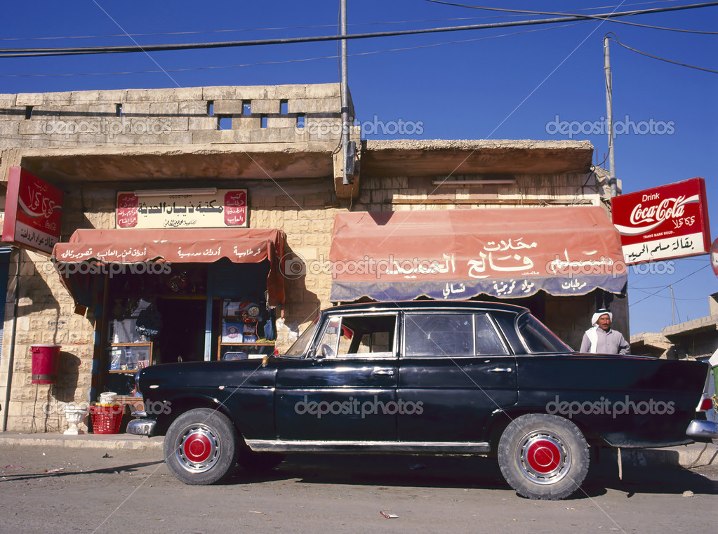SAMAR, JORDAN- MAY 5,1995; Street in a small village in Jordan near a cafe and with old black car. May, 5, 1995 Samar, Jordan — Stock Photo #8987154