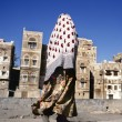 Veiled Muslim woman walks on Sana'a street, Yemen — Stock Photo