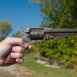 Stock Photo: Hand Holding Old Gun