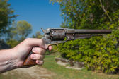 Hand Holding Old Gun — Stock Photo