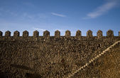 Parapet walk of a fortress. Stairway and merlons. — Stock Photo