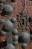 Door of a Church with keyhole and Metal Ornaments Shaped Shell. Spain, Euro — Stock Photo