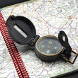 Compass in a map — Stock Photo