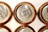 Row golden aluminum non alcoholic beer cans — Stock Photo