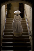 Victorian lady in castle stairs. 1900 Style. — Stock Photo