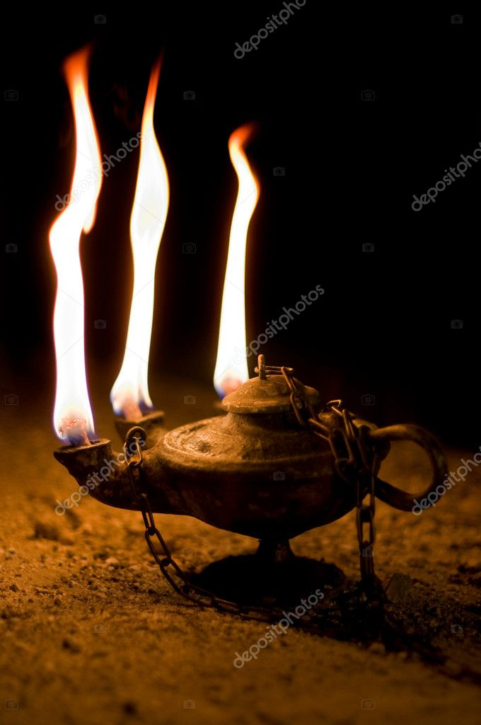 Aged Oil Lamp in dark cave — Stock Photo #8435032