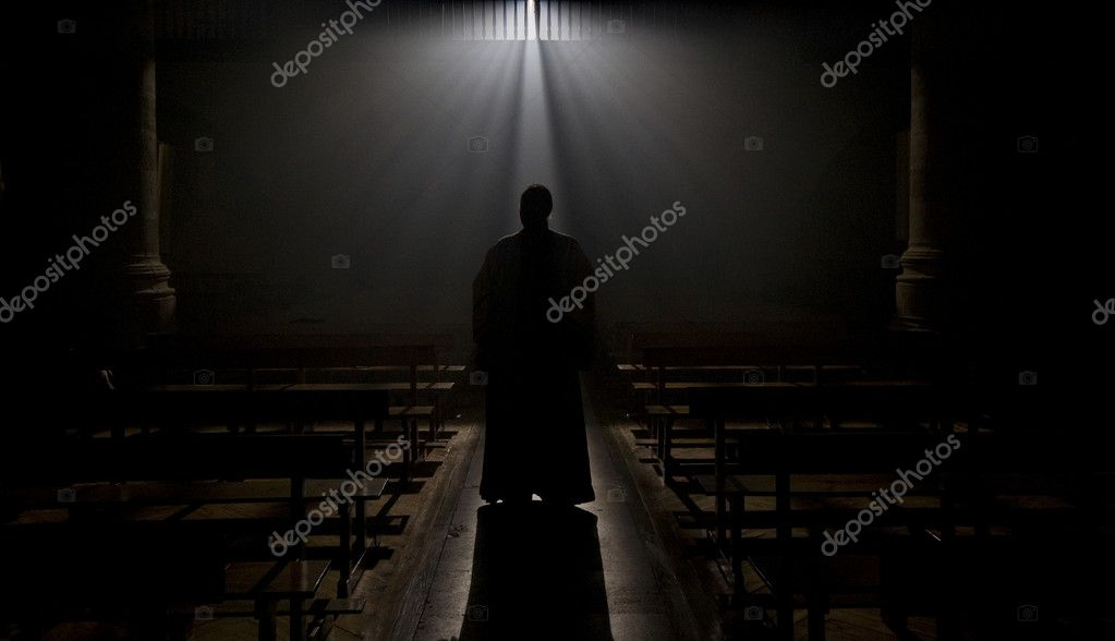 Monk in a Romanesque Church with a ray of divine light. — Stock Photo #8436628
