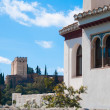 Moorish Window and Alhambra Palace. Granada, Spain — Stock Photo #8467108
