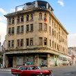 Royalty-Free Stock Photo: Typical Building and Vintage Car of La Havana.