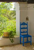 Antique Blue Wooden and Wicker Chair in a Porch and Sunlit Garden — Stock Photo
