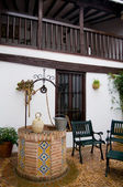 Well detail an botijo in Typical patio from Castilla la Mancha house. Posad — Stock Photo