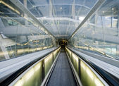 Tunnel in airport with mechanical passage — Stock Photo