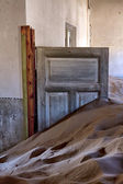 A dune in a house at kolmanskop ghost town near luderitz namibia — Stock Photo