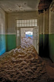 A strange dune in a house at kolmanskop ghost town namibia africa — Stock Photo