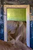 Dune in a house at kolmanskop ghost town namibia africa — Stock Photo