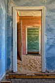 Dune in a house at kolmanskop ghost town — Stock Photo