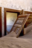 Ruin full of sand at kolmanskop ghost house near luderitz namibia — Stock Photo