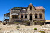 Ruine of an old house in kolmanskop namibia africa — Stock Photo