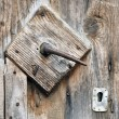 A very old door handle on a wooden door — Stock Photo