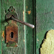 A very old door handle on a wooden door — Stock Photo #10254629