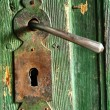 A very old door handle on a wooden door — Stock Photo #10254635