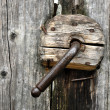 A very old door handle on a wooden door — Stock Photo #10254643