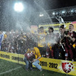 Soccer players celebrating league title with champagne — Stock fotografie #10727332
