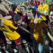 Soccer players celebrating the league title - Photo