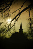 Church silhouette at sunset in Transylvania — Stock Photo