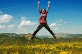 Beautiful young woman jumping — Stock Photo