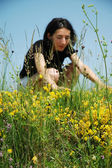 Beautiful portrait of a young sexy woman in a meadow — Stock Photo