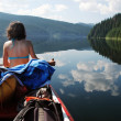 Canoeing girl on a lake — Stock Photo #8342426