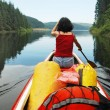 Canoeing girl on a lake — Stock Photo #8342434