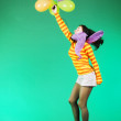 Jumping happy girl with balloons — Stock Photo #8342611