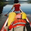 Canoeing girl on a lake — Stock Photo