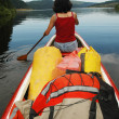 Stock Photo: Canoeing girl on lake