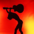 Woman with guitar silhouette on red background — Stock Photo #8342778