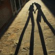 Shadow of walking lovers — Stock Photo