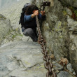A climber girl who arrives at the summit — Stock Photo #8345149